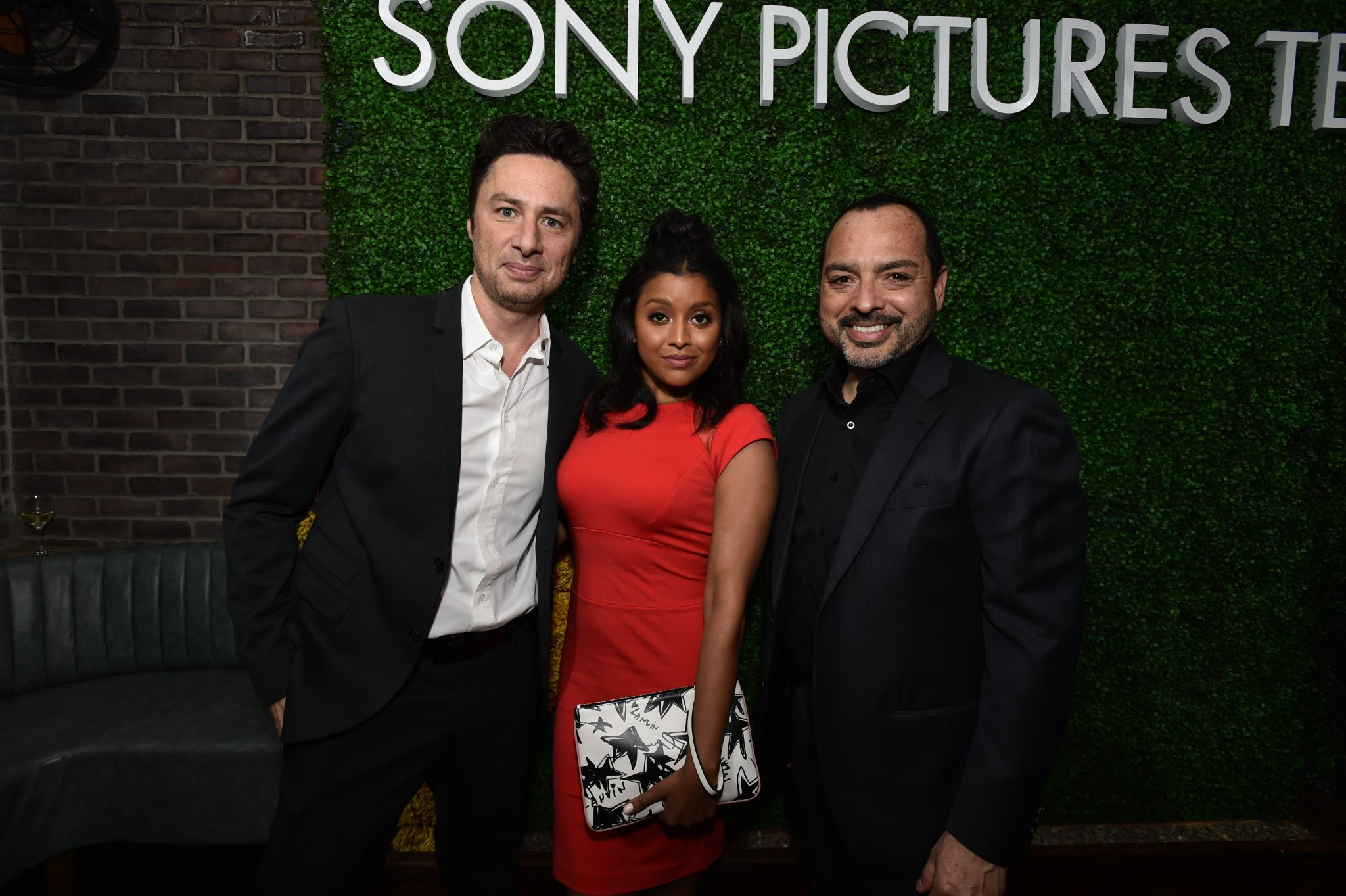 (L-R) Zach Braff & Tiya Sircar (Alex, Inc) with Sony EVP of international distribution, EMEA Angel Orengo, at an Sony Pictures Television party (May 24, 2017)